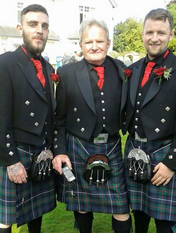 three men wearing traditional highland suits with kilts