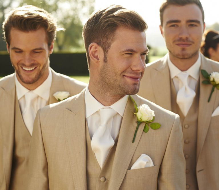A group of men in wedding suits