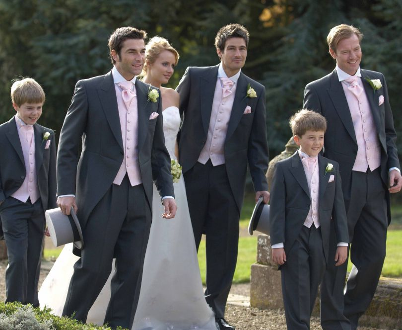 Wedding, men and children dressed in tailcoat suits